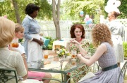 """""""THE HELP"""" 946_D_03188 Aibileen Clark (Viola Davis, standing) attends to the needs of Hilly Holbrook (Bryce Dallas Howard, seated center) and her friends Elizabeth Leefolt (Ahna O'Reilly, left) and Skeeter Phelan (Emma Stone, right). Ph: Dale Robinette ©DreamWorks II Distribution Co., LLC. All Rights Reserved."""