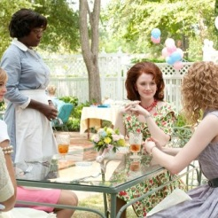 """THE HELP"" 946_D_03188 Aibileen Clark (Viola Davis, standing) attends to the needs of Hilly Holbrook (Bryce Dallas Howard, seated center) and her friends Elizabeth Leefolt (Ahna O'Reilly, left) and Skeeter Phelan (Emma Stone, right). Ph: Dale Robinette ©DreamWorks II Distribution Co., LLC.  All Rights Reserved."